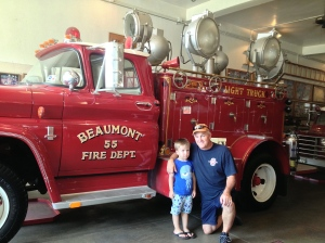A veteran fireman with his grandson,  possibly a future firefighter?!!?