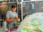 An Azucar employee scoops up a big helping of Cuban Flan ice cream!