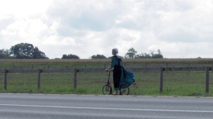 Young Amish woman on scooter