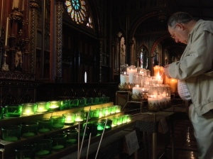 Lighting a candle in the basilica