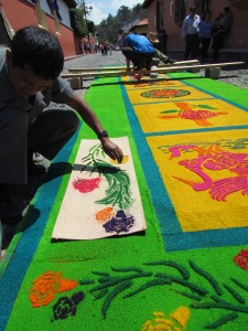 """Painting"" sawdust carpets for Semana Santa"
