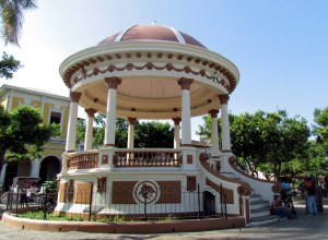 Locals hang around a beautifully detailed gazebo