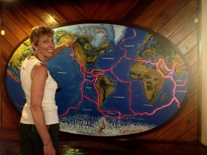 Gerda proudly points out her home! Note the dangerous pink lines of a mosaic of shifting oceanic and continental plates.