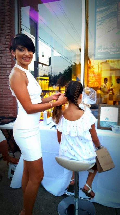 Vanity Salon on 19th St. provided hair braiding for a donation to their designated charity.